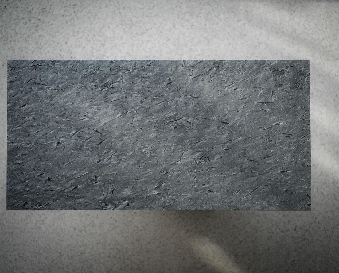 Bilde som viser en flis i Otta børstet skifer