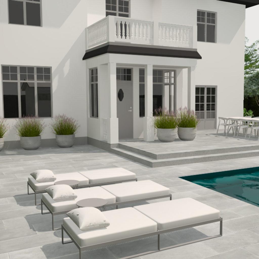 Et hvitt herskapelig hus med basseng og solsenger