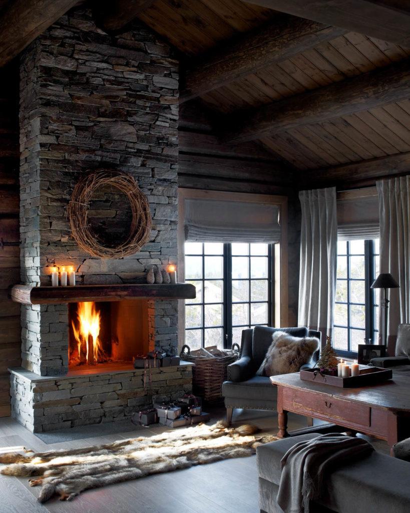 En hytte med en peis av  lys Oppdal skifer murstein tørrmur naturstein